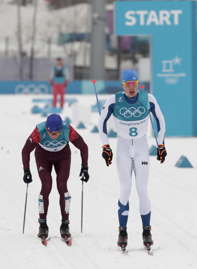 Iivo Niskanen, right, of Finland, and Alexander Bolshunov, of the team from Russia, race during men's 50k cross-country skiing competition at the 2018 Winter Olympics in Pyeongchang, South Korea, Saturday, Feb. 24, 2018. (AP Photo/Dmitri Lovetsky)