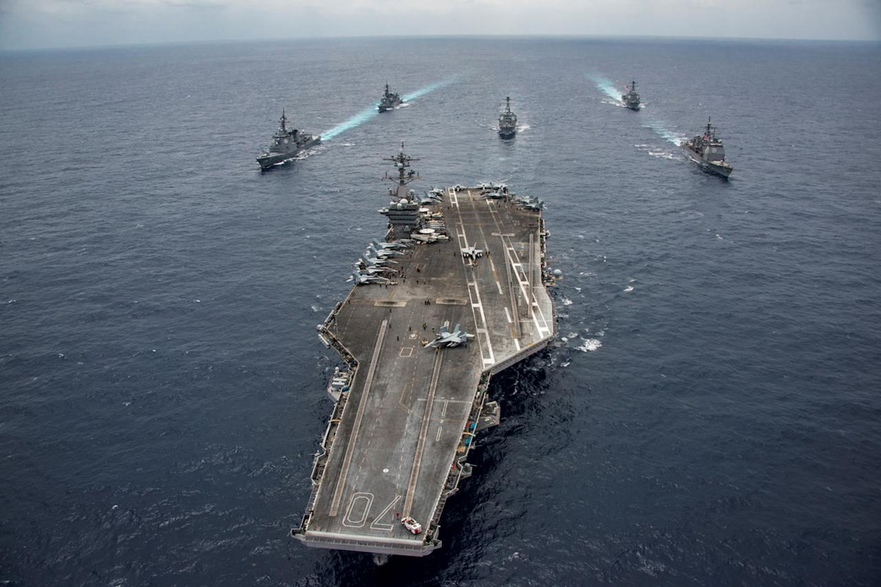 <p>The Japan Maritime Self-Defense Force destroyers JS Samidare and JS Ashigara, the U.S. Navy Arleigh Burke-class guided-missile destroyers USS Wayne E. Meyer and USS Michael Murphy, Ticonderoga-class guided-missile cruiser USS Lake Champlain and Nimitz-class aircraft carrier USS Carl Vinson transit the Philippine Sea, April 28, 2017. (U.S. Navy/Handout via Reuters) </p>