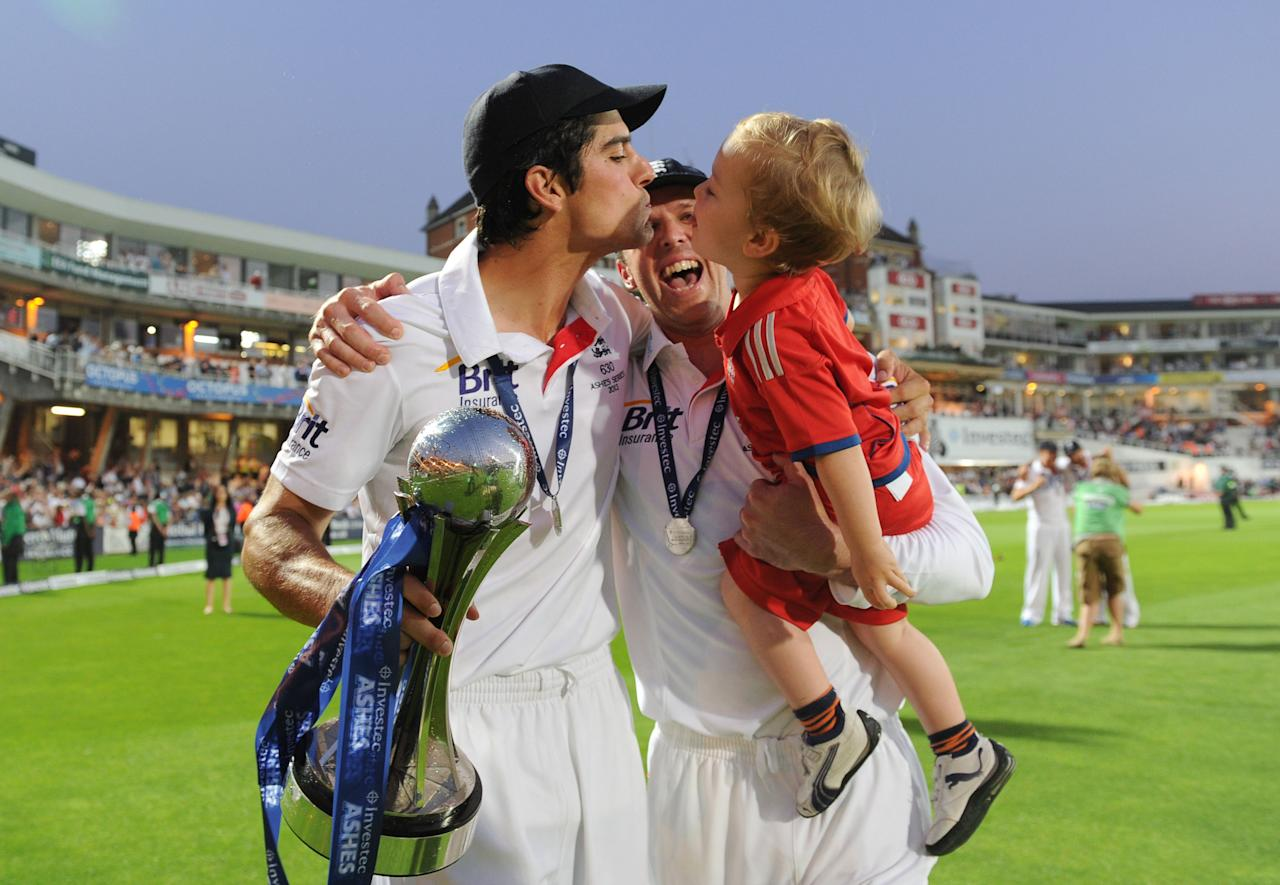 England captain Alastair Cook celebrates with Graeme Swann and his son Wilfred after winning the Ashes Series during day five of the Fifth Investec Ashes Test match at The Kia Oval, London.
