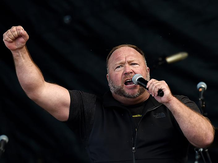 US far-right radio show Alex Jones speaks to supporters of US President Donald Trump as they demonstrate in Washington, DC, on December 12, 2020, to protest the 2020 election.