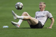 Manchester City's Oleksandr Zinchenko plays a ball during a training session ahead of the Champions League final match at the Dragao stadium in Porto, Portugal, Friday, May 28, 2021. Manchester City and Chelsea will play the Champions League final on Saturday. (AP Photo/Manu Fernandez)