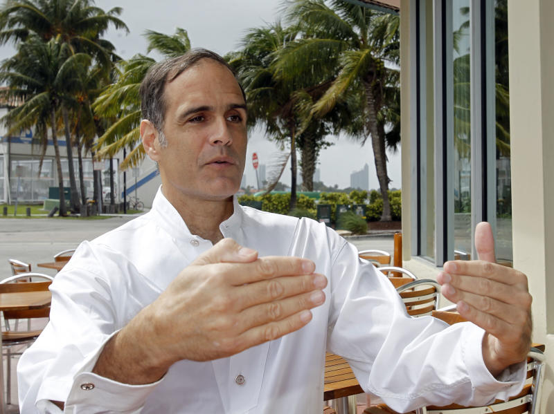 in this photo taken Wednesday, March 7, 2012, Fane Lozman gestures as he talks to a reporter in Miami Beach, Fla. Lozman, a 50-year-old former Chicago financial trader, seemingly lost his nearly six-year battle with the seaside city of Riviera Beach, Fla., when his floating home was hauled away in 2009 and destroyed by court order. But Lozman refused to give up, claiming officials vindictively and illegally targeted him for eviction from the city's marina because of his vocal opposition to a major redevelopment plan. (AP Photo/Alan Diaz)