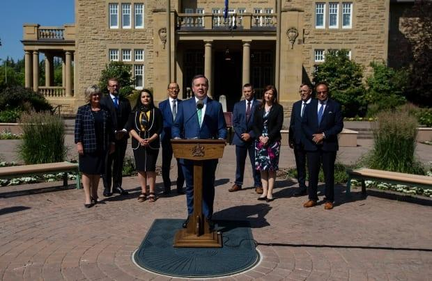Alberta Premier Jason Kenney and his new cabinet ministers hold a press conference after a cabinet shuffle at Government House in Edmonton on Thursday, July 8, 2021. (Jason Franson/The Canadian Press - image credit)