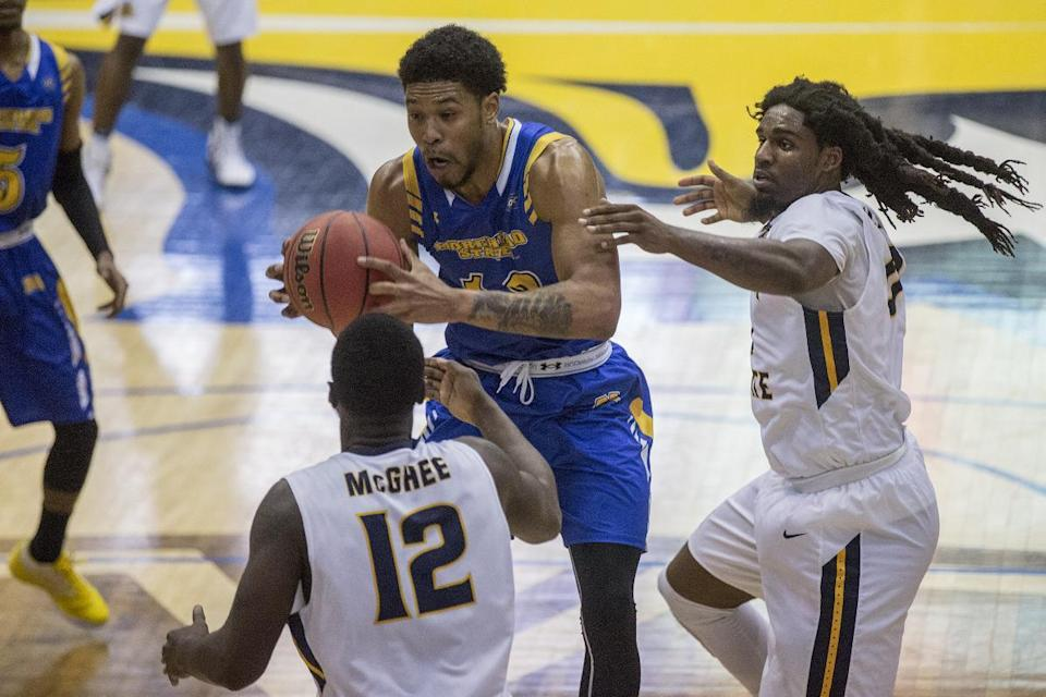 Terrell Miller's hair is hard to miss for Murray State. (AP)