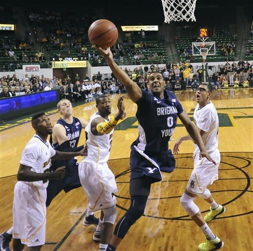 Brigham Young's Brandon Davies (0) scores past Baylor's Isaiah Austin, right ,and Cory Jefferson, center left, during the first half of an NCAA college basketball game, Friday, Dec. 21, 2012, in Waco, Texas. (AP Photo/Waco Tribune Herald, Rod Aydelotte)