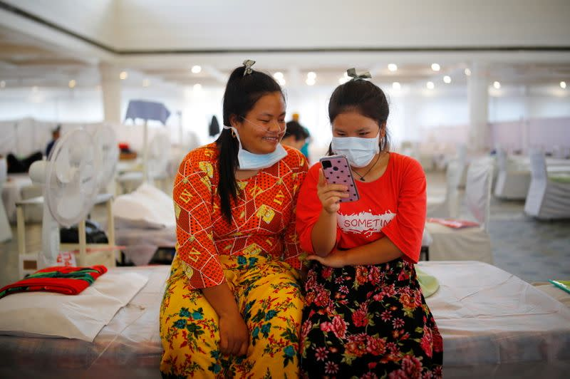 Indian Jew girls, members of the Bnei Menashe, suffering from the coronavirus disease, look at a mobile phone at a COVID-19 care facility inside a Gurudwara or a Sikh Temple, in New Delhi