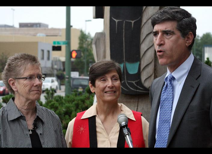 In this Aug. 3, 2010 file photo, Julie Schmidt, left, Gayle Schuh , middle, and Jeffrey Mittman with the American Civil Liberties Union speak at a news conference in Anchorage, Alaska. An Anchorage judge on Monday ruled same Alaska same-sex couples are entitled to the same senior citizen and disabled veteran property tax exemptions as married couples. The ACLU filed the lawsuit against the state of Alaska and the Municipality of Anchorage on behalf of Schmidt and Schuh and two other same sex couples, claiming the state of Alaska's tax assessment rules providing exemptions for senior citizens and disabled veterans discriminate against same sex couples. (AP Photo/Mark Thiessen)