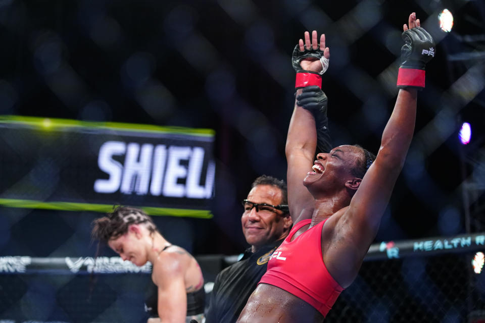 Claressa Shields, right, reacts after winning a Professional Fighters League mixed martial arts bout against Brittney Elkin in Atlantic City, N.J., Friday, June 11, 2021. (AP Photo/Matt Rourke)