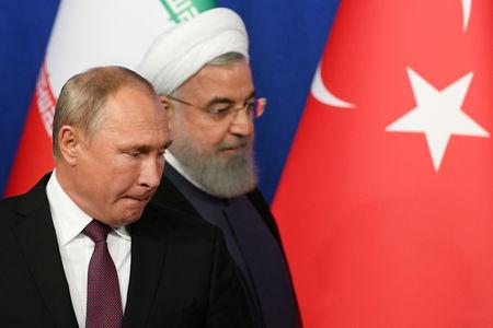Russian President Vladimir Putin and his Iranian counterpart Hassan Rouhani arrive for a news conference following their meeting in Tehran, Iran September 7, 2018. Kirill Kudryavtsev/Pool via REUTERS