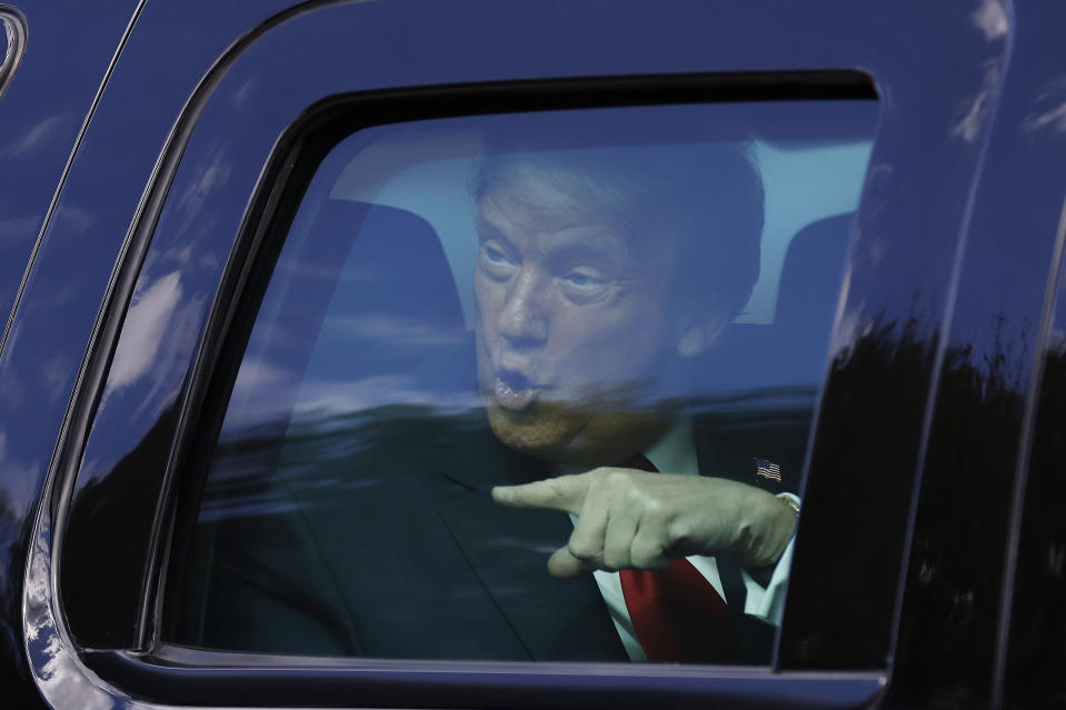 WEST PALM BEACH, FLORIDA - JANUARY 20: Outgoing US President Donald Trump waves to supporters lined along on the route to his Mar-a-Lago estate on January 20, 2021 in West Palm Beach, Florida. Trump, the first president in more than 150 years to refuse to attend his successor's inauguration, is expected to spend the final minutes of his presidency at his Mar-a-Lago estate in Florida. (Photo by Michael Reaves/Getty Images)