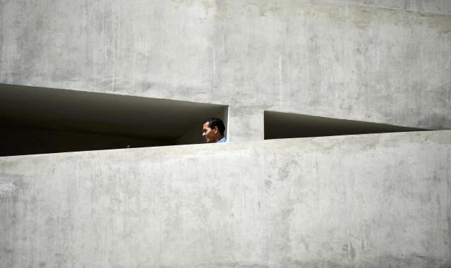 A workers strolls down some stairs at the Dunas arena soccer stadium in Natal, June 12 , 2014. Mexico will face Cameroon in their 2014 World Cup football match here on June 13. REUTERS/Dylan Martinez (BRAZIL - Tags: SOCCER SPORT WORLD CUP)