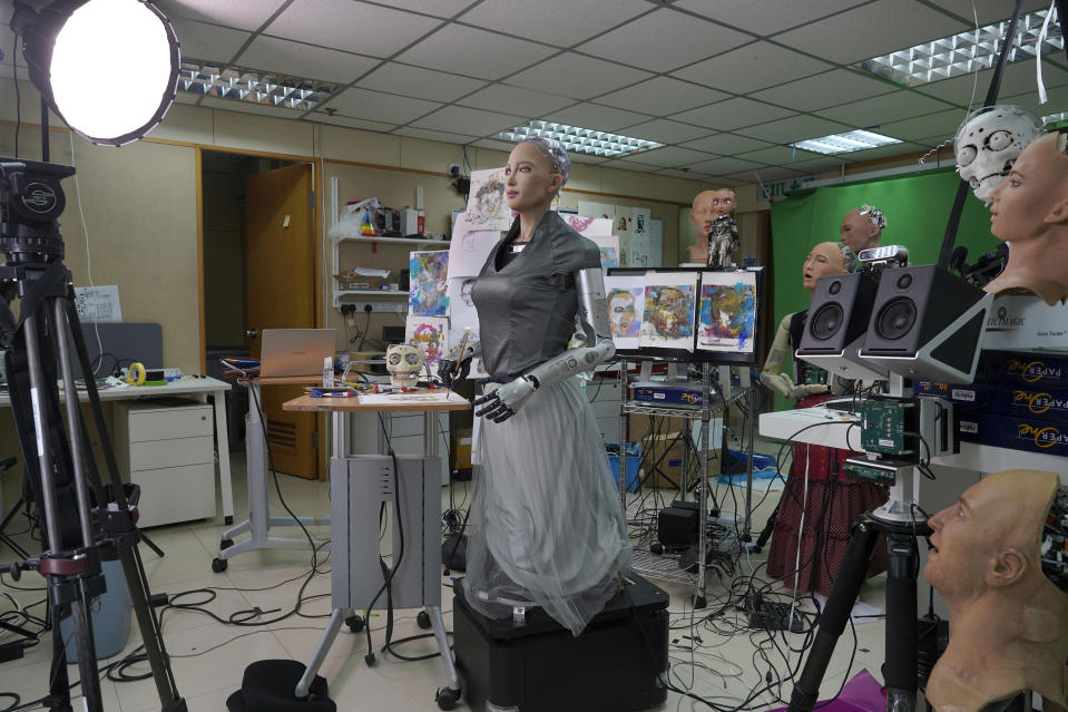 Sophia receives interview at Hanson Robotics studio in Hong Kong on March 29, 2021. Sophia is a robot of many talents — she speaks, jokes, sings and even makes art. In March, she caused a stir in the art world when a digital work she created as part of a collaboration was sold at an auction for $688,888 in the form of a non-fungible token (NFT). (AP Photo/Vincent Yu)