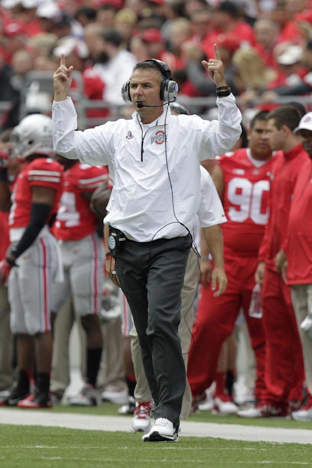 Ohio State head coach Urban Meyer signals to his team during the first quarter of an NCAA college football game against Florida A&M Saturday, Sept. 21, 2013, in Columbus, Ohio. (AP Photo/Jay LaPrete)