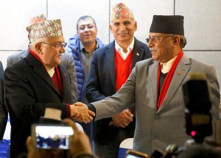 File Photo: Chairman of Communist Party of Nepal (Unified Marxist-Leninist) (CPN-UML) party Khadga Prasad Sharma Oli, also known as K.P. Oli, (L) shakes hands with the chairman of Communist Party of Nepal (Maoist Centre) Pushpa Kamal Dahal, also known as Prachanda, during a news conference in Kathmandu, Nepal December 17, 2017.  REUTERS/Navesh Chitrakar