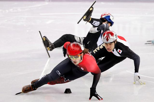 Short Track Speed Skating Events - Pyeongchang 2018 Winter Olympics - Men's 500m Quarterfinals - Gangneung Ice Arena - Gangneung, South Korea - February 22, 2018 - Samuel Girard of Canada leads Ryosuke Sakazume of Japan as Seo Yi-ra of South Korea falls. REUTERS/John Sibley TPX IMAGES OF THE DAY
