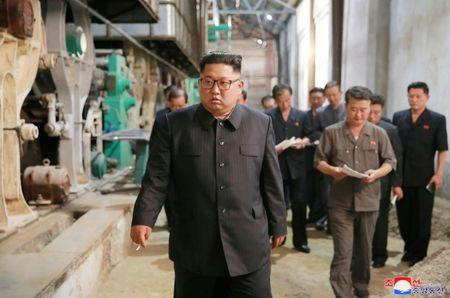 FILE PHOTO: North Korea's leader Kim Jong Un tours a factory in Sinuiju, North Korea, in this undated photo released by North Korea's Korean Central News Agency (KCNA) July 2, 2018. REUTERS/KCNA