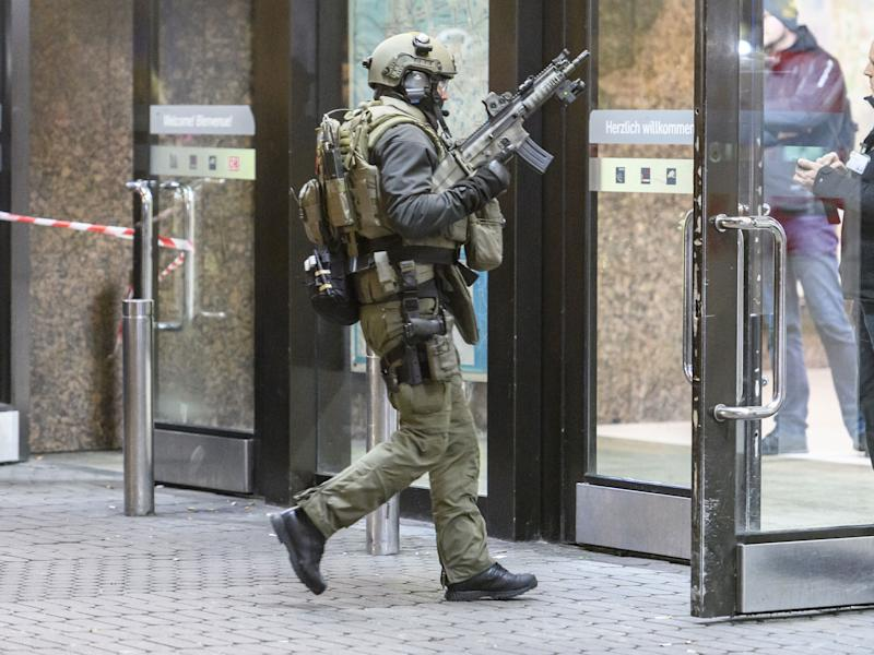 Police enter the main railway station in Dusseldorf following what police described as an axe attack: Getty