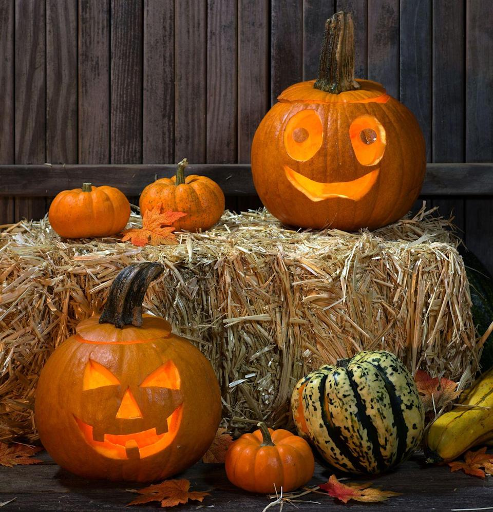 """<p>An easy way to prepare your home for Halloween is to add some hay bales to the mix. Top them with jack-o'-lanterns or other decorations to complete the look. </p><p><a class=""""link rapid-noclick-resp"""" href=""""https://www.amazon.com/GrandpaS-Best-Timothy-Hay-Bale/dp/B079QHP7PL/?tag=syn-yahoo-20&ascsubtag=%5Bartid%7C10055.g.4602%5Bsrc%7Cyahoo-us"""" rel=""""nofollow noopener"""" target=""""_blank"""" data-ylk=""""slk:SHOP HAY BALES"""">SHOP HAY BALES</a></p>"""