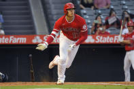 Los Angeles Angels designated hitter Shohei Ohtani drops his bat as he hits and RBI triple during the first inning of a baseball game against the Seattle Mariners Saturday, Sept. 25, 2021, in Anaheim, Calif. (AP Photo/Mark J. Terrill)