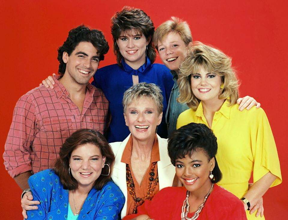 THE FACTS OF LIFE, (clockwise from top left): George Clooney, Nancy McKeon, Mackenzie Astin, Lisa Whelchel, Kim Fields, Cloris Leachman, and Mindy Cohn, (Season 8), 1979-1988. (Photo: Embassy Pictures/Everett Collection)