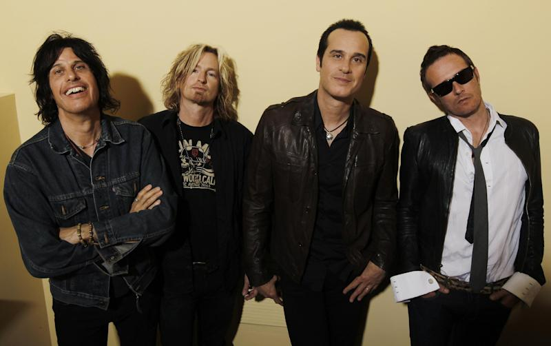 FILE - This April 30, 2010 file photo shows the Stone Temple Pilots, from left, Dean Deleo, Eric Kretz, Robert Deleo, and Scott Weiland from the band Stone Temple Pilots, pose for a portrait in Santa Monica, Calif. Stone Temple Pilots have accused the band's former frontman Weiland of hijacking its name and songs to promote his solo career. The lawsuit filed Friday, May 24, 2013, in Los Angeles accuses Weiland of being chronically late to concerts and interfering with the release of a new single by the group. (AP Photo/Matt Sayles, file)