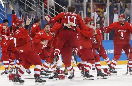 Ice Hockey - Pyeongchang 2018 Winter Olympics - Men's Final Match - Russia - Germany - Gangneung Hockey Centre, Gangneung, South Korea - February 25, 2018 - Olympic Athlete from Russia Kirill Kaprizov reacts with teammates after scoring a goal. REUTERS/Kim Kyung-Hoon