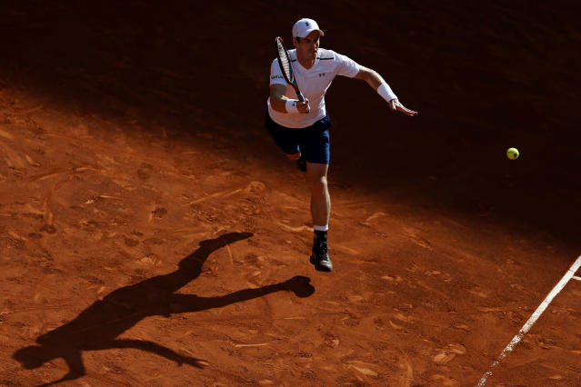 <p>Andy Murray from Britain lunges to return a ball to Marius Copil from Romania during a Madrid Open tennis tournament match in Madrid, Spain, Tuesday, May 9, 2017. Murray won 6-4 and 6-3. (Photo: Francisco Seco/AP) </p>
