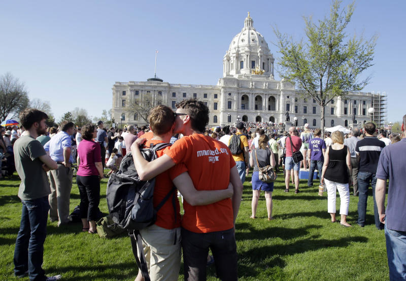 FILE – In this May 14, 2013, file photo crowd gathers at the State Capitol in St. Paul, where Minnesota Gov. Mark Dayton signed gay marriage into law. Three states and three countries have approved same-sex unions in just the two months since the Supreme Court heard arguments on gay marriage. Close observers on both sides of the divide are wondering whether such developments might affect the justices' consideration, particularly that of Justice Anthony Kennedy, which is likely to be decisive. (AP Photo/Jim Mone, File)