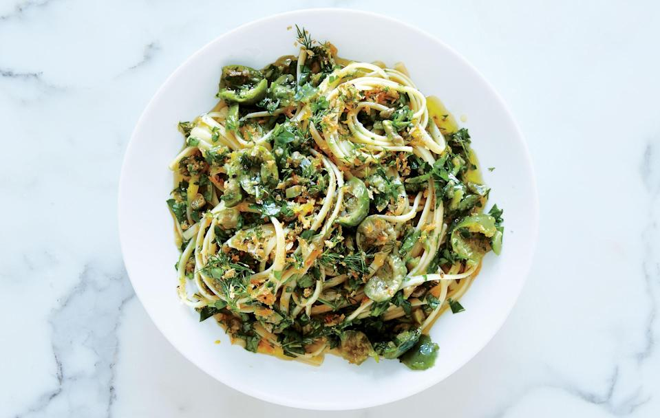 """Bursting with the big brash flavors of green olives, anchovies, and capers, this herbaceous pasta sauce isn't afraid to bite back. <a href=""""https://www.bonappetit.com/recipe/linguine-green-olive-sauce-zesty-breadcrumbs?mbid=synd_yahoo_rss"""" rel=""""nofollow noopener"""" target=""""_blank"""" data-ylk=""""slk:See recipe."""" class=""""link rapid-noclick-resp"""">See recipe.</a>"""