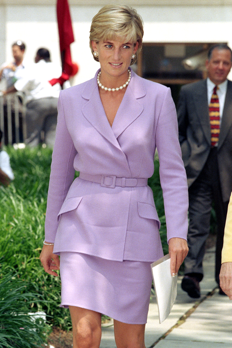 <p>Ah yes, this is one of Di's most elegant skirt suits - a heavenly lavender combo worn for a visit to Washington in June 1997.</p>