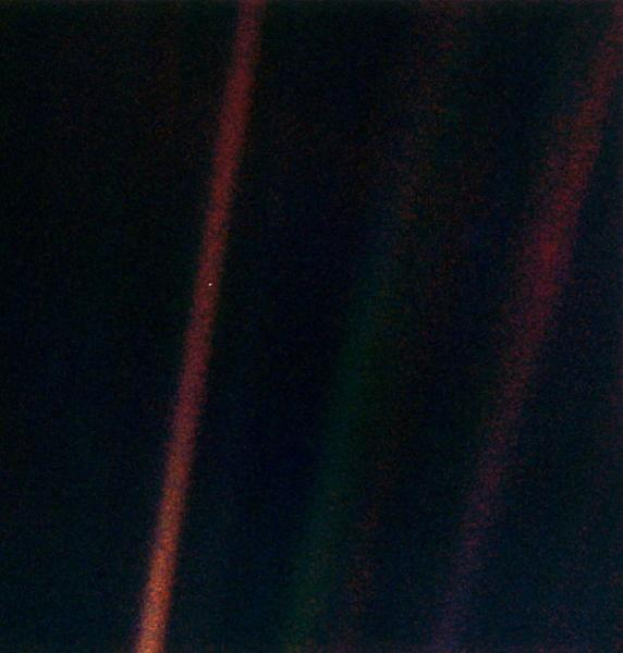 "This narrow-angle color image of the Earth s a part of the first ever ""portrait"" of the solar system taken by Voyager 1. The spacecraft acquired a total of 60 frames for a mosaic of the solar system from a distance of more than 4 billion miles"