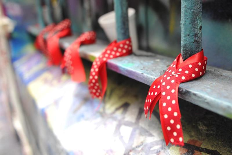 Red ribbons, a symbol of solidarity for people living with HIV/AIDS, are displayed on a window at Hosier Lane in conjunction with the AIDS Conference 2014 in Melbourne, Australia, on July 22, 2014