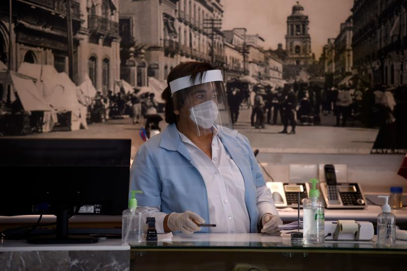 A worker of La Blanca Restaurant wears protective gear in Mexico City, on July 01, 2020 during the COVID-19 pandemic. - Starting this week Mexico City is allowing the reopening of restaurants, shops, street markets and athletic complexes but with limited capacity and hours. (Photo by Alfredo ESTRELLA / AFP) (Photo by ALFREDO ESTRELLA/AFP via Getty Images)