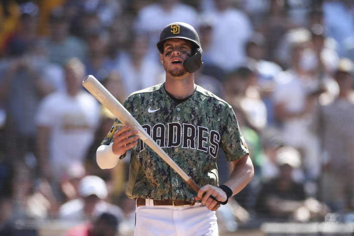 San Diego Padres' Wil Myers reacts after being called out on strikes in the ninth inning of a baseball game against the Colorado Rockies, Sunday, July 11, 2021, in San Diego. (AP Photo/Derrick Tuskan)