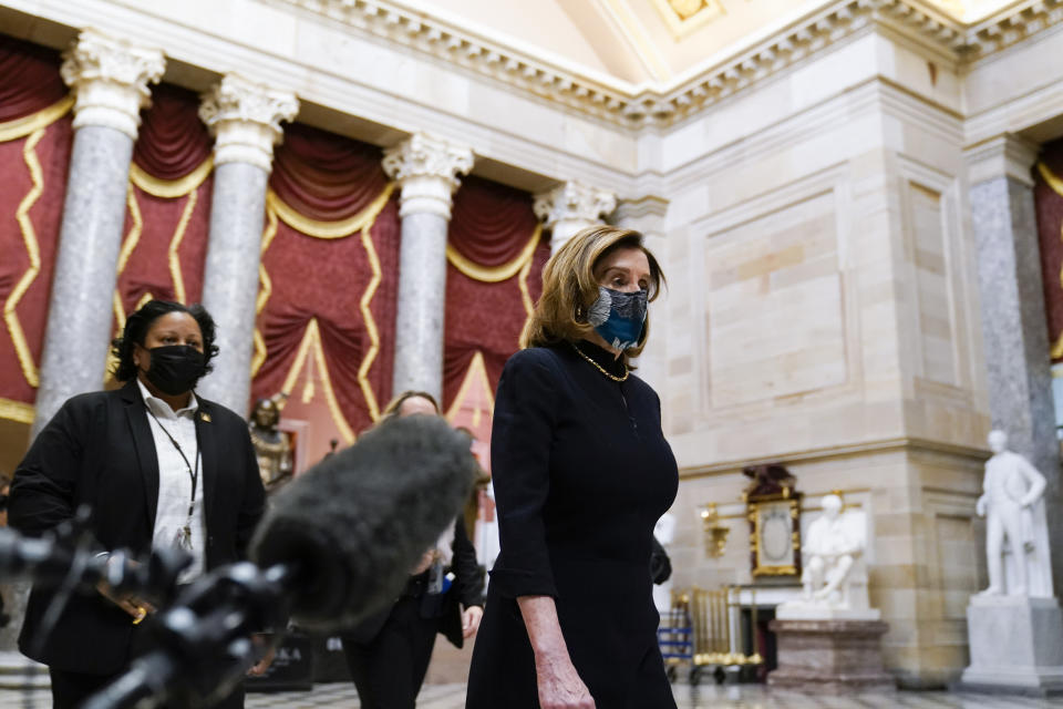 Speaker of the House Nancy Pelosi of Calif., returns to her leadership office from the House chamber at the Capitol in Washington, Wednesday, Jan. 13, 2021, as the House of Representatives pursues an article of impeachment against President Donald Trump for his role in inciting an angry mob to storm the Capitol last week. (AP Photo/Susan Walsh)