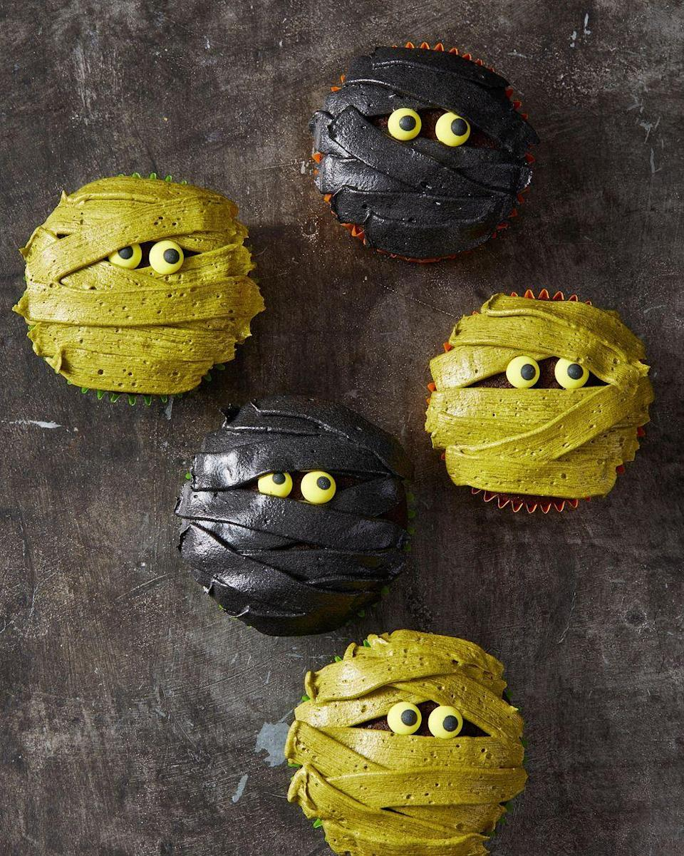 """<p>Your guests will be dying to unwrap one of these ghoulish treats.</p><p><em><a href=""""https://www.goodhousekeeping.com/food-recipes/party-ideas/a28593338/mummy-cupcakes-recipe/"""" rel=""""nofollow noopener"""" target=""""_blank"""" data-ylk=""""slk:Get the recipe for Mummy Cupcakes »"""" class=""""link rapid-noclick-resp"""">Get the recipe for Mummy Cupcakes »</a></em></p>"""