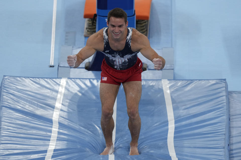 Samuel Mikulak, of the United States, performs on the vault during the artistic gymnastic men's all-around final at the 2020 Summer Olympics, Wednesday, July 28, 2021, in Tokyo. (AP Photo/Gregory Bull)