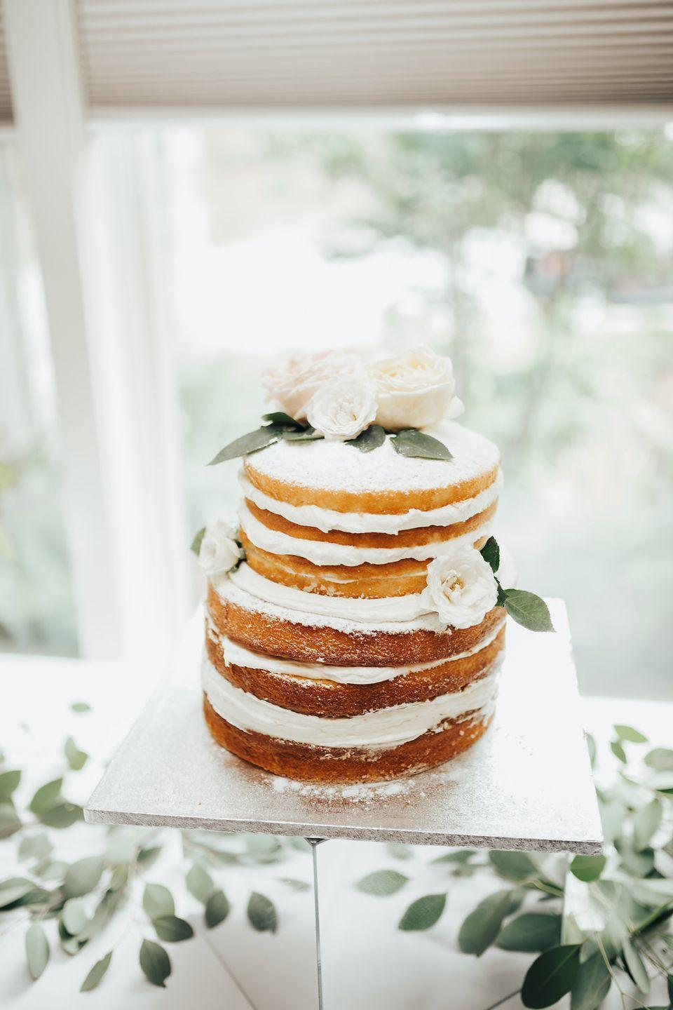 """<p>Naked cakes are huge right now—and you can swap out the frosting and <a href=""""https://www.fiftyflowers.com/"""" rel=""""nofollow noopener"""" target=""""_blank"""" data-ylk=""""slk:blooms"""" class=""""link rapid-noclick-resp"""">blooms</a> based on the season and your wedding colors.</p>"""