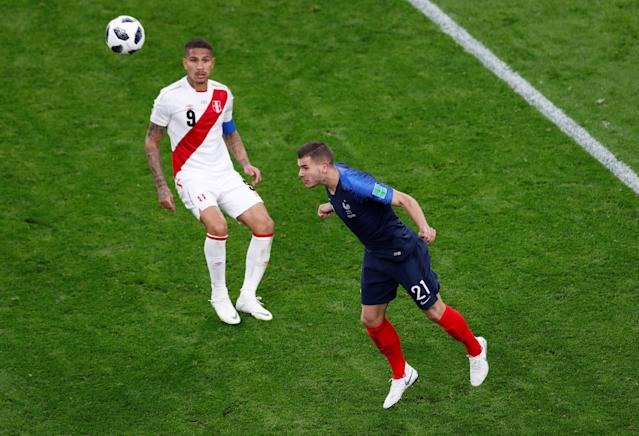 Soccer Football - World Cup - Group C - France vs Peru - Ekaterinburg Arena, Yekaterinburg, Russia - June 21, 2018 France's Lucas Hernandez in action with Peru's Paolo Guerrero REUTERS/Andrew Couldridge
