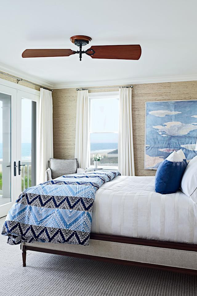 "<p><a href=""http://www.coastalliving.com/homes/decorating/entertainers-paradise"" target=""_blank"">Tour the rest of this home.</a></p> <p>Arrowroot wallpaper evokes the dunes outside, while ocean-going John Robshaw bedding and sunny day-inspired artwork complete this Rehoboth Beach guest room's seaside allure.</p>"
