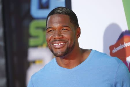 Former NFL player Michael Strahan poses at the 2014 Nickelodeon Kids' Choice Sports awards in Los Angeles