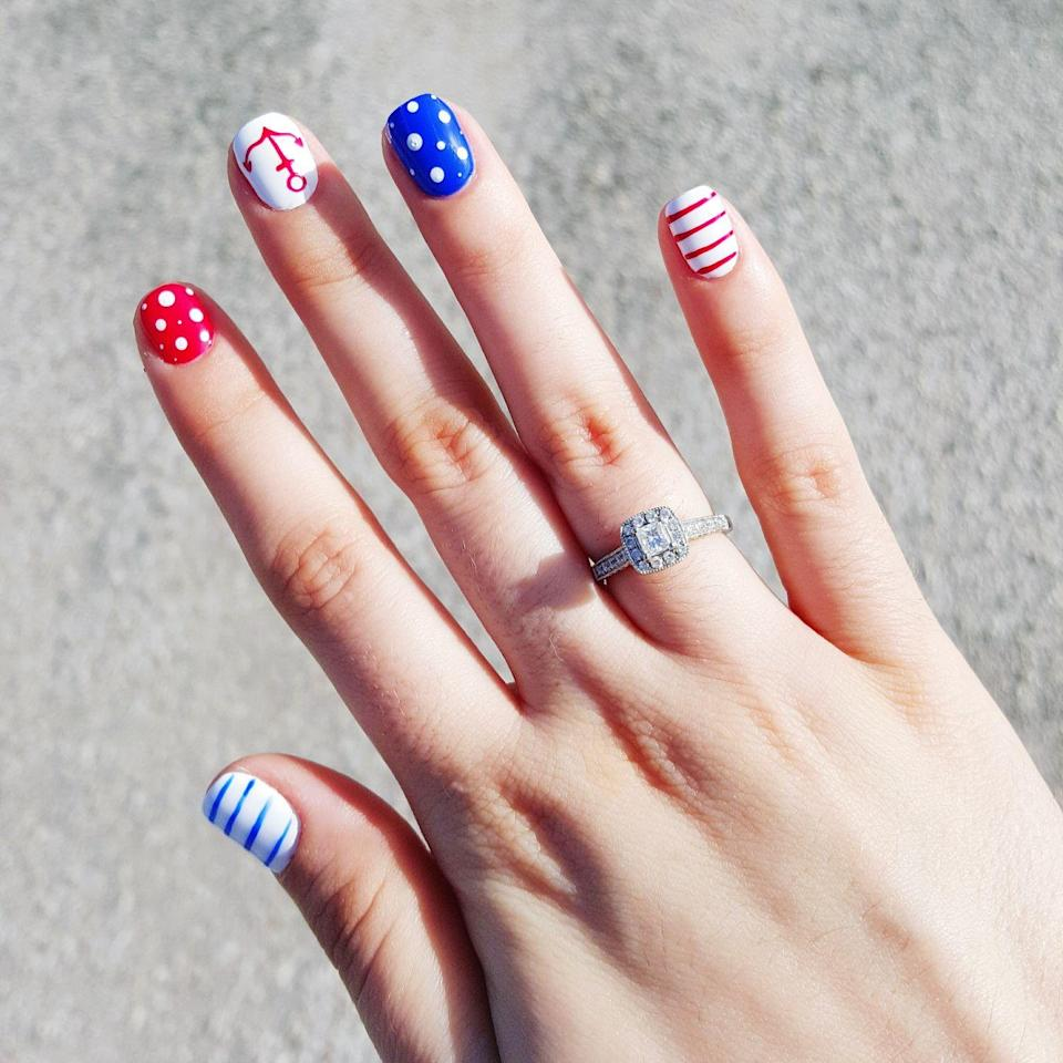 """<p>Make your manicure stand out by drawing on red, blue and white dots and stripes, and add a nail sticker to the mix to make it even more fun!</p><p><a class=""""link rapid-noclick-resp"""" href=""""https://www.amazon.com/TailaiMei-Summer-Stickers-Self-adhesive-Stencil/dp/B07MWYWXC9/?tag=syn-yahoo-20&ascsubtag=%5Bartid%7C10055.g.1278%5Bsrc%7Cyahoo-us"""" rel=""""nofollow noopener"""" target=""""_blank"""" data-ylk=""""slk:SHOP NAIL DECALS"""">SHOP NAIL DECALS</a></p>"""