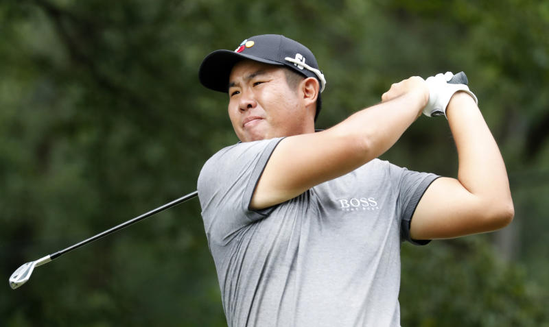 Byeong Hun An watches his tee shot on the fourth hole hole during the third round of the Wyndham Championship golf tournament at Sedgefield Country Club in Greensboro, N.C. Saturday, Aug. 3, 2019. (AP Photo/Chris Seward)