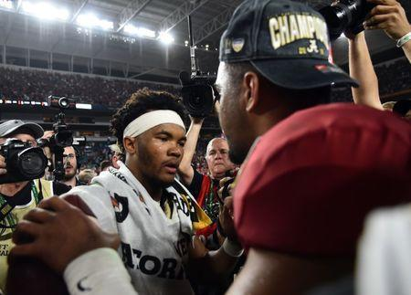 FILE PHOTO: Dec 29, 2018; Miami Gardens, FL, USA; Alabama Crimson Tide quarterback Tua Tagovailoa (13) hugs Oklahoma Sooners quarterback Kyler Murray (1) after the 2018 Orange Bowl college football playoff semifinal game at Hard Rock Stadium. Mandatory Credit: Jasen Vinlove-USA TODAY Sports