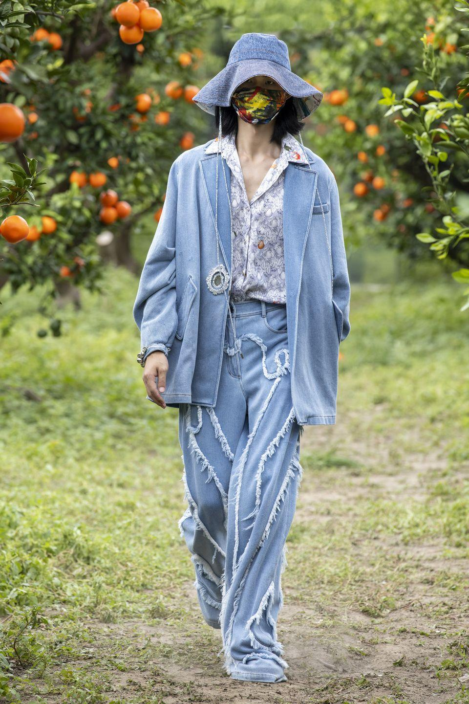 <p>Mithridate's SS22 collection entitled 'The Mirror Stage' was shot in a mirrored orange orchard in Shanghai, but presented to audiences through a digital experience. Founder and creative rirector Demon Zhang was inspired by the psychoanalytic theory by Jacques Lacan, based on the belief that a child's personal apperception of oneself develops at six months old, establishing the recognition of themselves in a mirror and thereafter introducing the formation of the ego.</p>