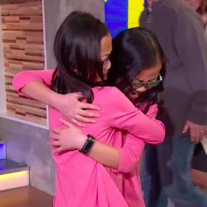 Watch identical twin girls meet for the first time after being adopted to different families, and yes, you will cry