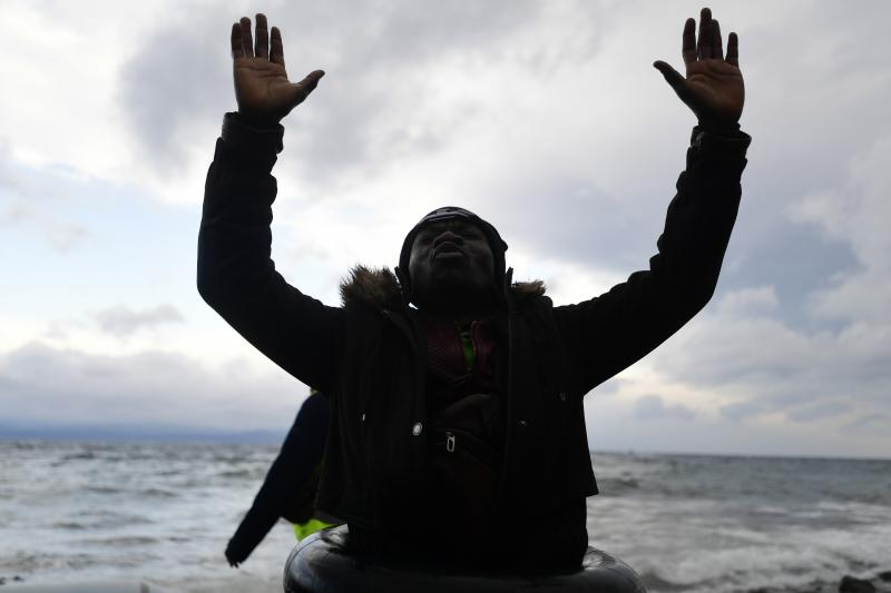 A man reacts as he arrives with other migrants at the village of Skala Sikaminias, on the Greek island of Lesbos, after crossing the Aegean sea from Turkey, Saturday, Feb. 29, 2020. Hundreds of refugees and migrants in Turkey have begun heading for the country's land and sea borders with Greece, buoyed by Turkish officials' statements indicating they will not be hindered from crossing the frontier to head into Europe. (AP Photo/Michael Varaklas)