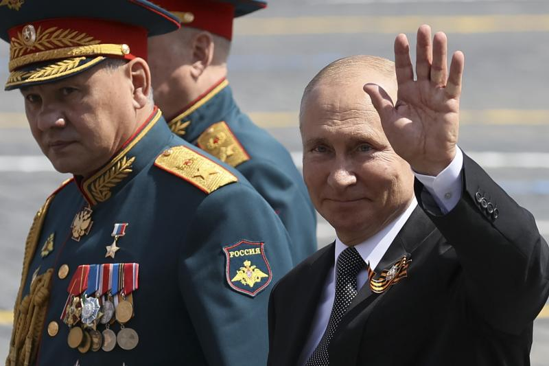 FILE - In this June 23, 2020, file photo, Russian President Vladimir Putin, right, and, Defense Minister Sergei Shoigu leave Red Square after the Victory Day military parade marking the 75th anniversary of the Nazi defeat in Moscow, Russia. Putin is just a step away from bringing about the constitutional changes that would allow him to extend his rule until 2036. The vote that would reset the clock on Putin's tenure in office and allow him to serve two more six-year terms is set to wrap up Wednesday, July 1, 2020. (Yekaterina Shtukina/Sputnik Kremlin Pool Photo via AP, File)
