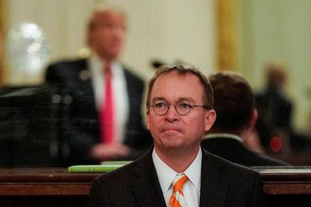FILE PHOTO: White House Acting Chief of Staff Mulvaney watches as U.S. President Trump welcomes the 2018 College Football Playoff National Champion Clemson Tigers in Washington
