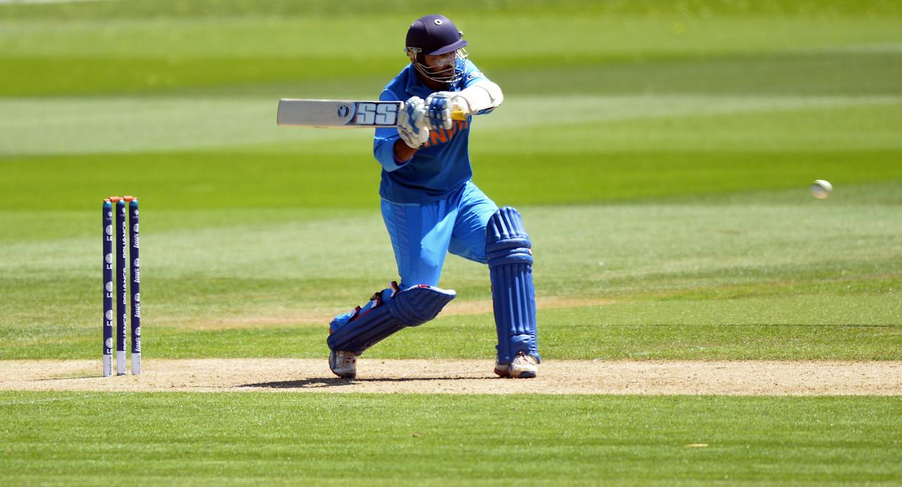 India's Dinesh Karthik plays a shot during the warm-up cricket match ahead of the 2013 ICC Champions Trophy between India and Australia at The Cardiff Wales Stadium in Cardiff, Wales on June 4, 2013.  India won the toss and elected to bat first.  AFP PHOTO/Paul ELLIS        (Photo credit should read PAUL ELLIS/AFP/Getty Images)
